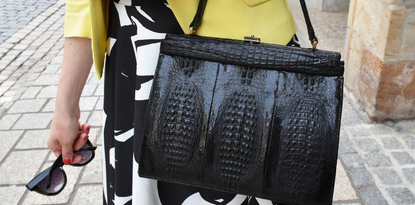 Handtasche und Sonnenbrille in schwarz