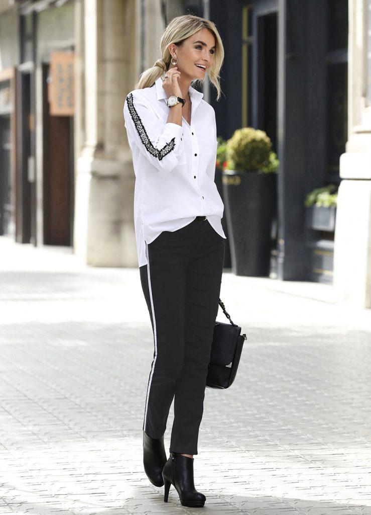 Die schwarze Stoffhose ist ein absolutes Basic-Teil im Kleiderschrank