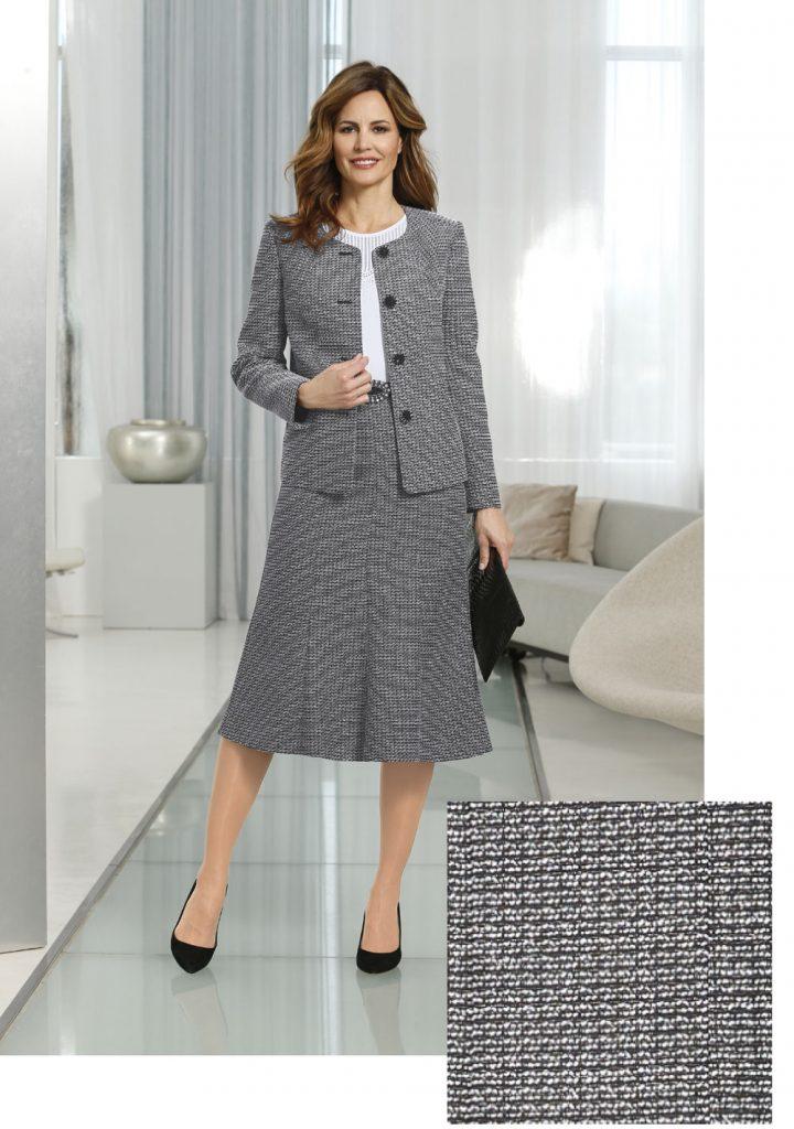 Frau im Herbst Outfit fürs Büro mit wadenlangem Rock und Blazer in Grau