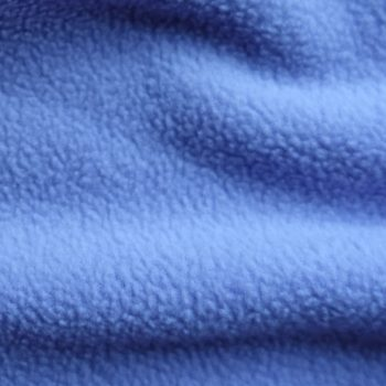 Thick blue fleece fabric in soft folds